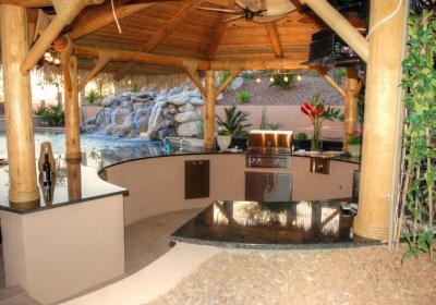 Sunk In Outdoor Kitchen With Waterfall Backdrop